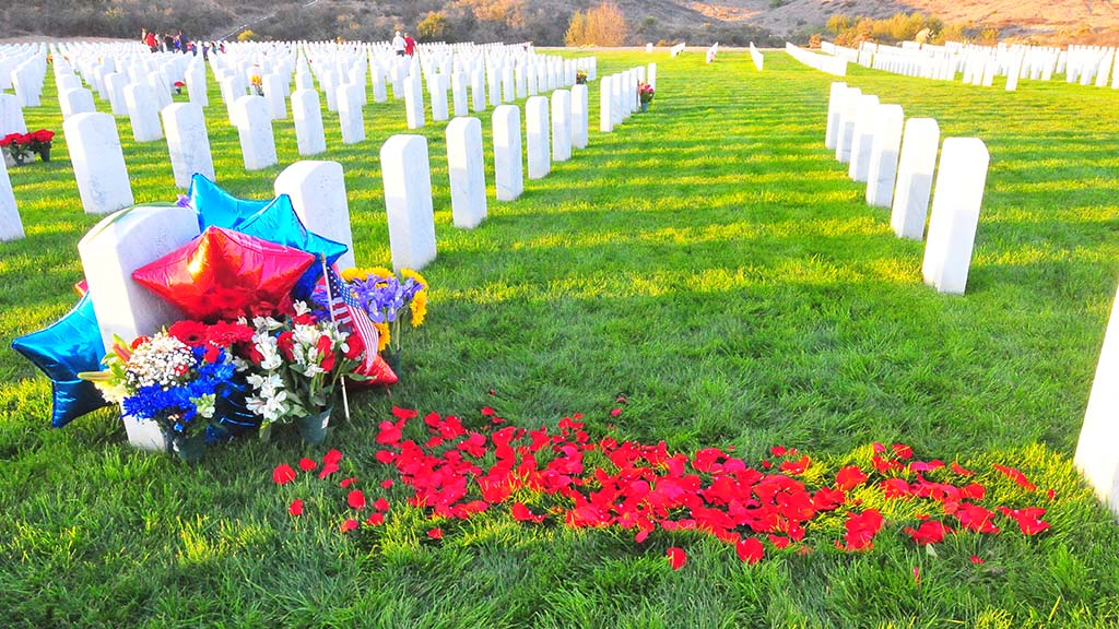 The grave of Marine Sgt. Walter E. Janeke was decorated with balloons, flowers and rose petals at Miramar National Cemetery.