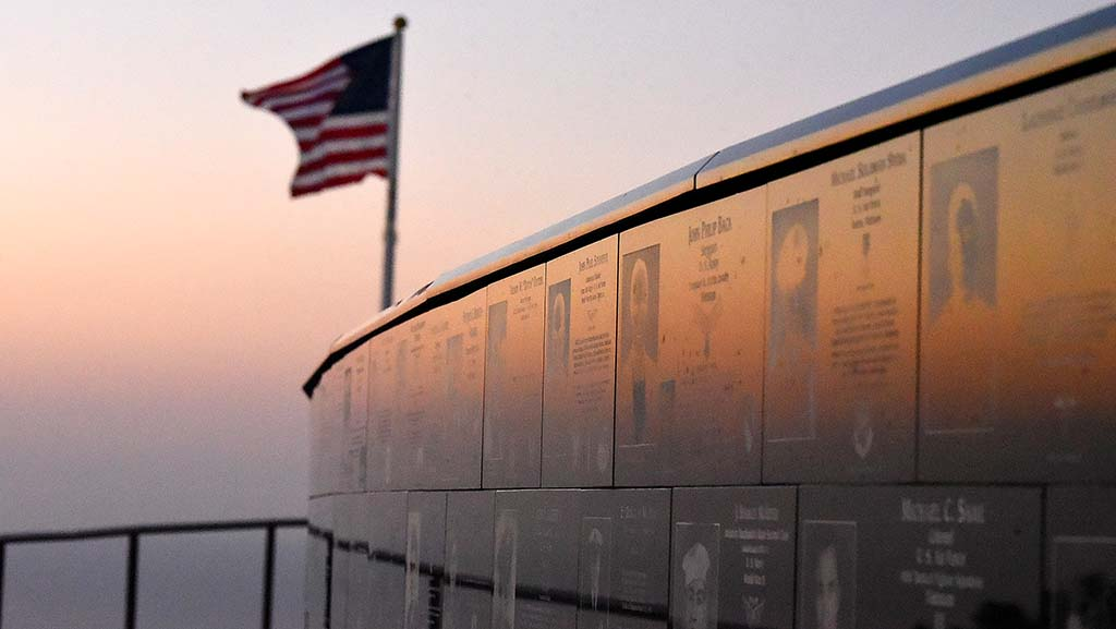 Plaques at Mt. Soledad National Veterans Memorial are bathed in the light of a sunset.