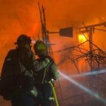 Firefighters battling the Woolsey Fire