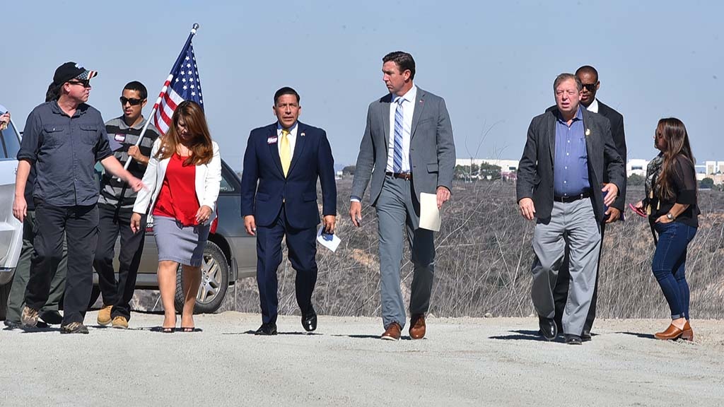 Rep. Duncan Hunter and aides, along with fellow House candidate Juan Hidalgo Jr., arrive for press conference.