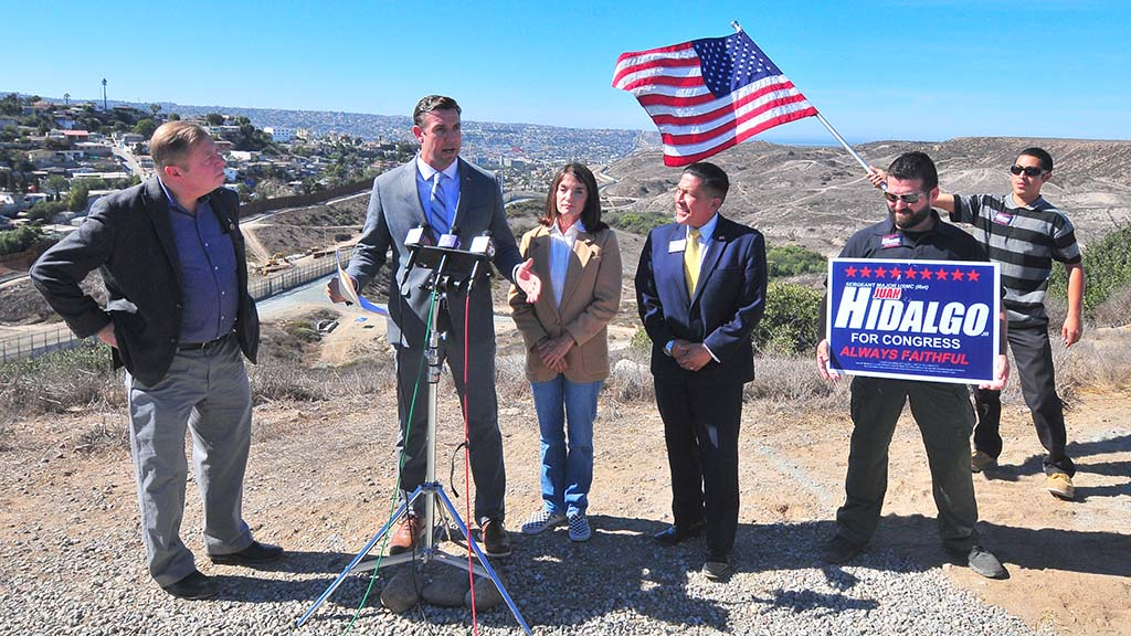 Rep. Duncan Hunter speaks while Chris Harris (left), Diane Harkey and Juan Hidalgo Jr. look on.