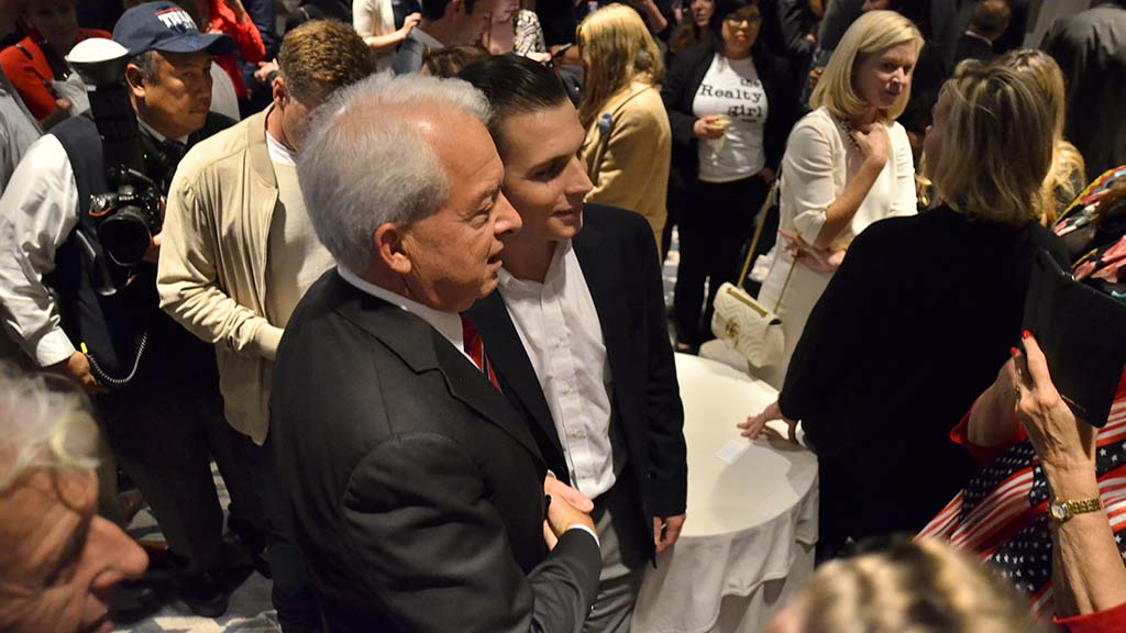 Governor candidate John Cox shakes hands with supporter Jake Stanford of Bonita.