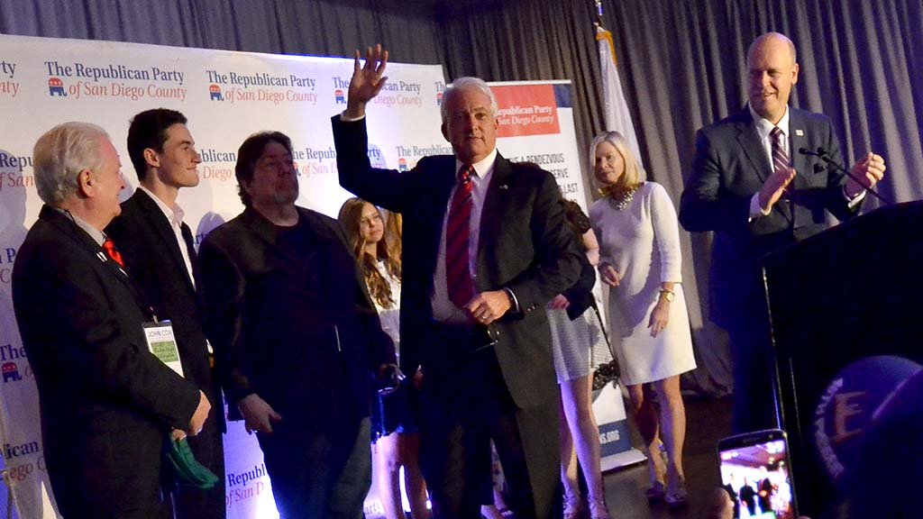 John Cox makes a final wave goodbye to fellow Republicans (including county party chair Ton Krvaric at lectern).