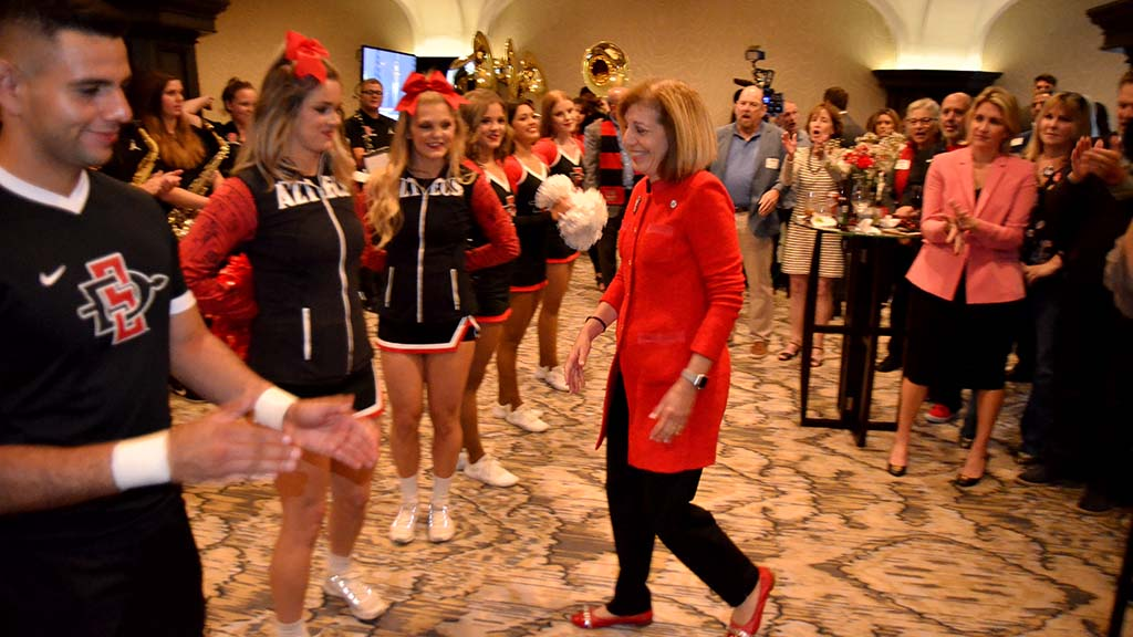 Councilwoman Barbara Bry gets applause from fellow SDSU West supporters as she walks to stage at U.S. Grant Hotel.