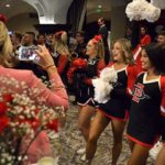 SDSU cheerleaders, backed by the Aztec Pep Band, celebrate Measure G victory at the U.S. Grant Hotel.
