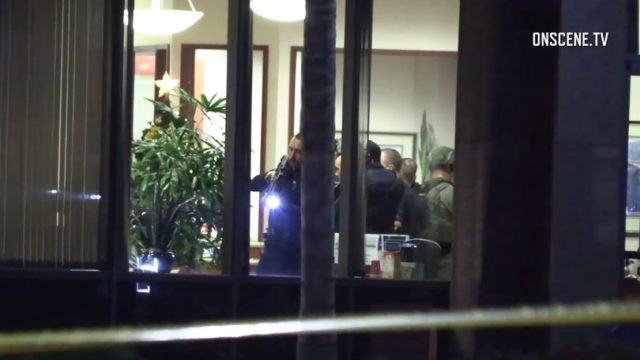 San Diego Police officer points gun inside bank