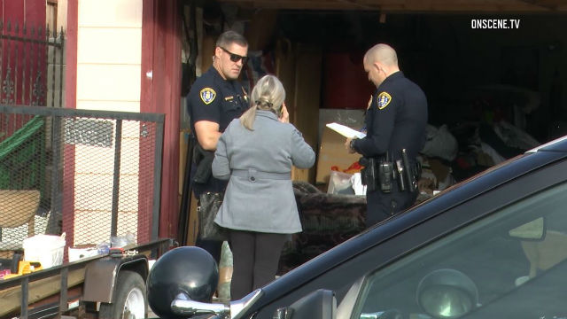 Officers examine evidence at Bay Terraces home