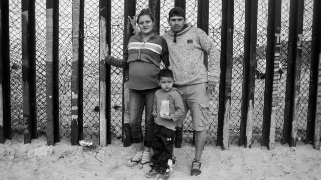 A family at the border wall in Tijuana separating the U.S. and Mexico.