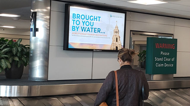 """Brought to You by Water"" campaign on airport monitor"