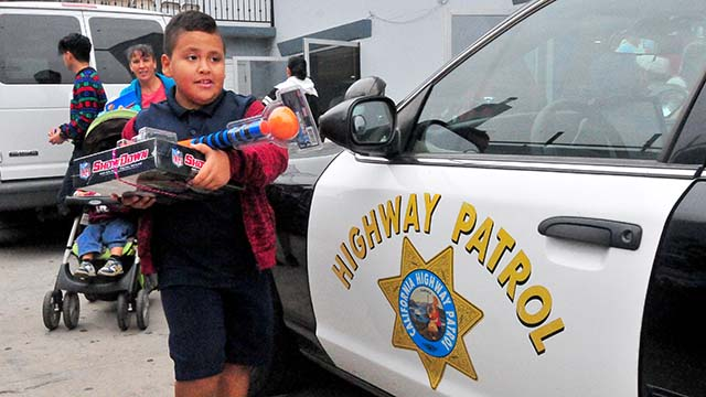 A young boy scored free gifts from the California Highway Patrol and the Light of the World Church.