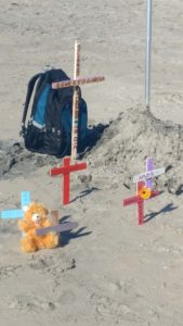 Crosses at Friendship Park Beach in Playas de Tijuana were placed in memory of a young male migrant who recently drowned swimming around the border fence and two children who died in Border Patrol custody.