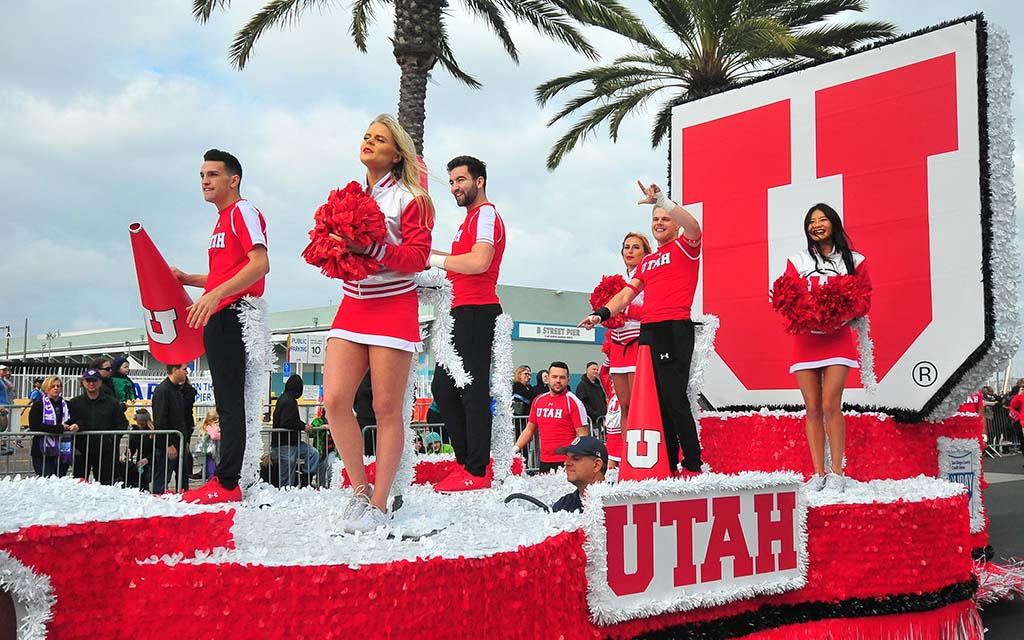 Driver of Utah cheerleaders float is nearly submerged with his wheel.