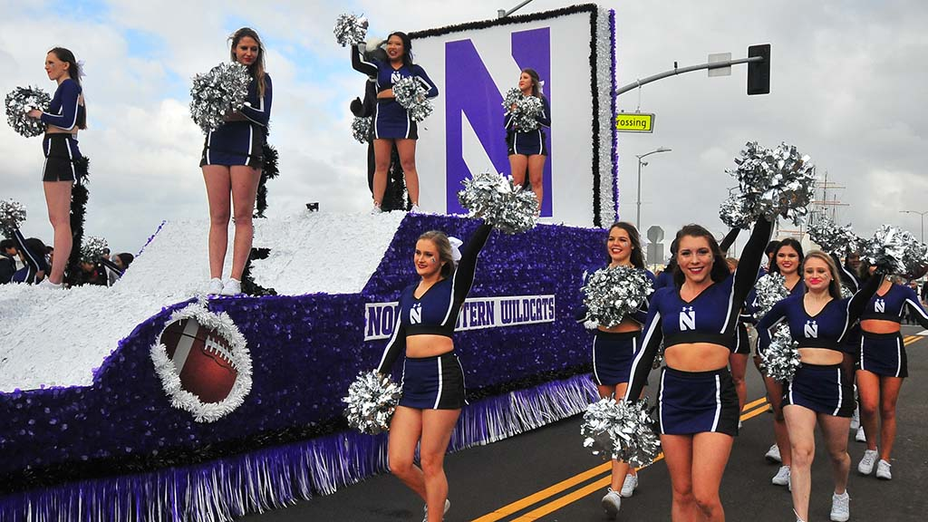 Northwestern cheerleaders keep spirits warm on a relatively chilly day by San Diego Bay.