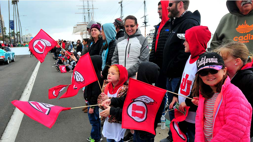 Utes fans near the Star of India show their colors along the parade route.