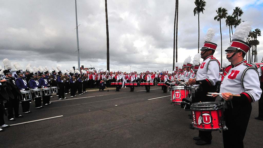 Before the parade, the Utah and Northwestern marching bands engage in a drum battle.