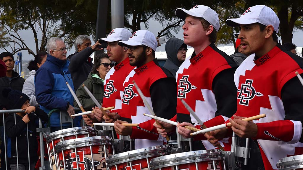 San Diego State's drumline adds a beat to Holiday Bowl Parade.