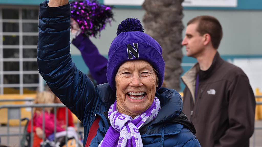 A Northwestern fan came dressed for warmth at the Holiday Bowl Parade.