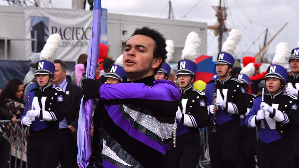 Northwestern Wildcat Marching Band members keep their heads up on a cool day.