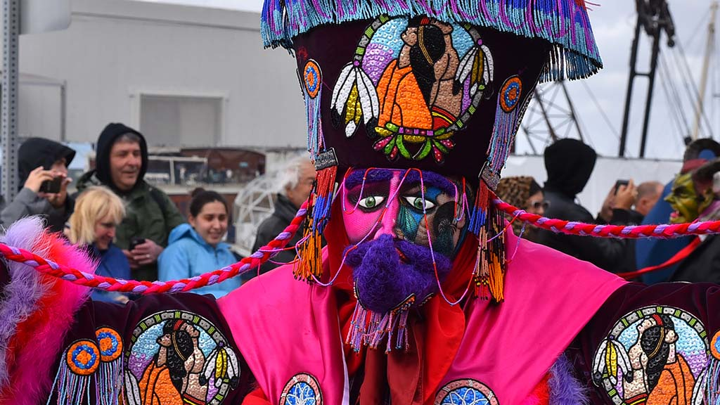 A member of Chinelos de Morelos, a Mexican dance troupe, was well-costumed.