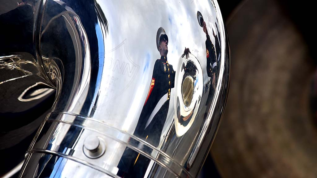 Members of Marine Band San Diego are reflected in a sousaphone at Holiday Bowl Parade.