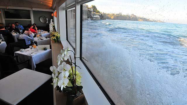 King tide waves spash against Marine Room