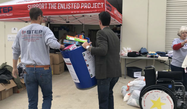 Mark Kersey and Tony Teravainen unload gifts for military families