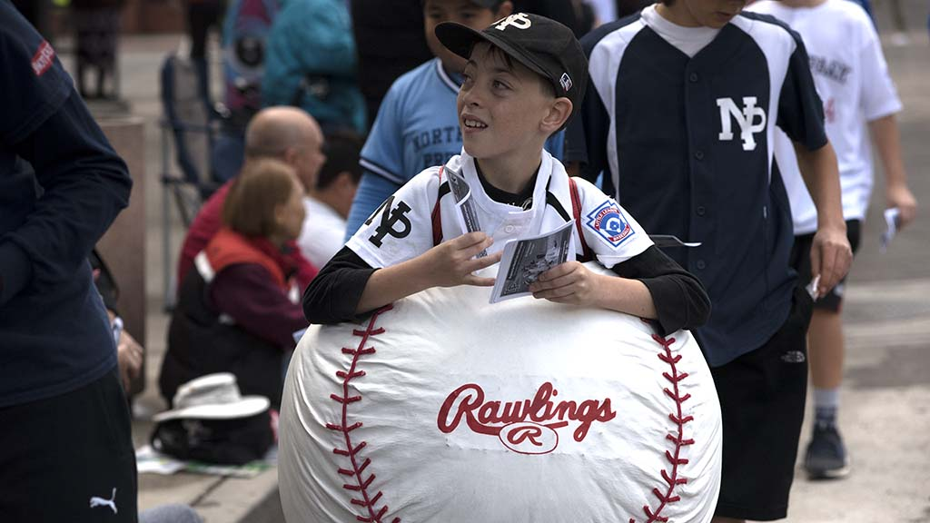 Tommy Potts, 10, hands out flyers for his North Park Little League Team.