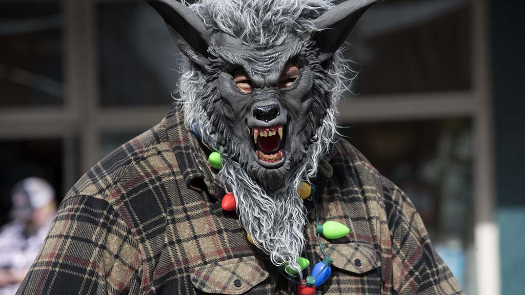A member of Nature's Elements Landscaping may look scary, but his lights show he is in the holiday spirit.