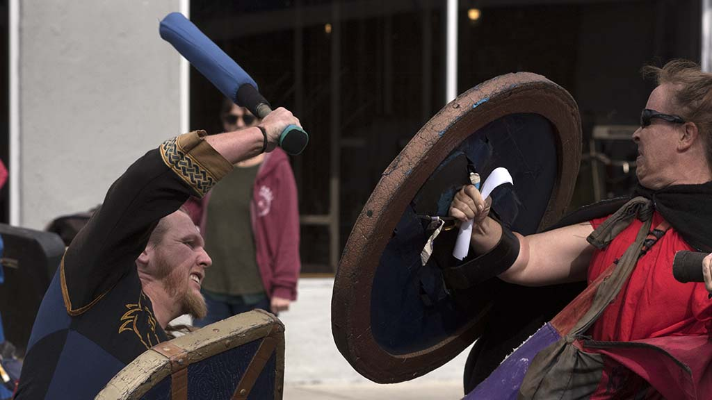 Members of the Belegarth Medieval Combat Society have a mock battle along the parade route.