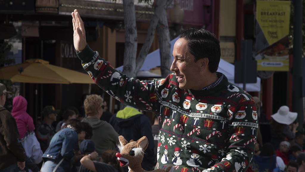 State Assemblman Todd Gloria, dressed in a holiday sweater, greeted the spectators.