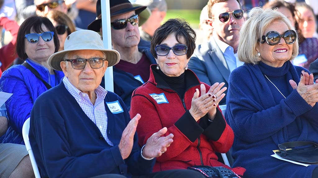 Herbert Solomon, his wife Elaine Galinson (daughter of Joseph Glickman) and Joan Jacobs (left to right) applaud a speaker at a Hannukah Celebration at the future home of the Beverly and Joseph Glickman Hillel Center in La Jolla.