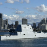 The future USS Michael Monsoor passes the downtown skyline