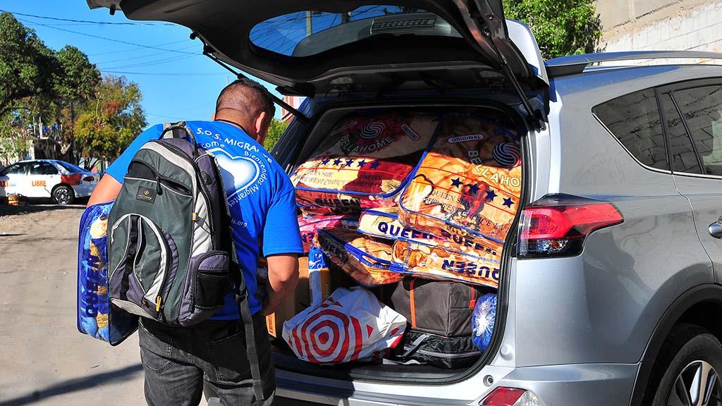 Border Angel volunteer Joey Castanieto readies to distribute tent, blanket and tarp donations to migrants inside El Barretal.