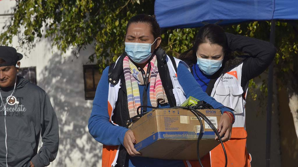 World Vision health workers leave the shelter after assisting migrants.