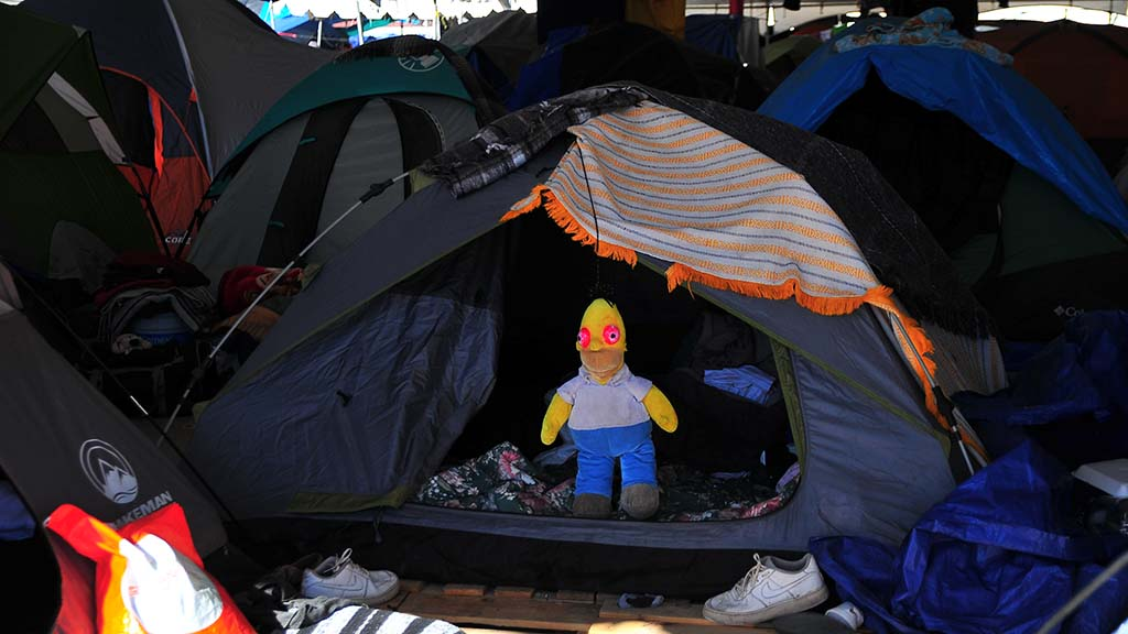 Families are given tents which are crowded under tents in the El Barretal shelter.