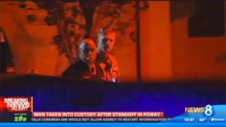 Bryon Edward Henry is shown being taken into custody at Poway hom