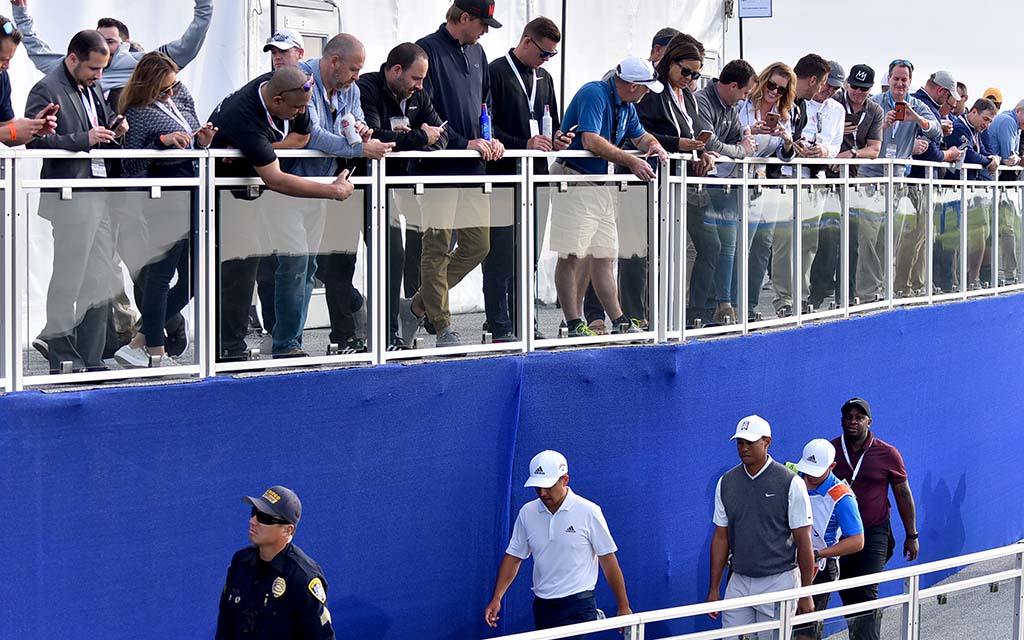 Spectators cheer Tiger Woods as he walks to next hole on South Course.