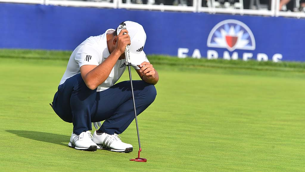 Xander Schauffele of San Diego reacts after missing a putt.