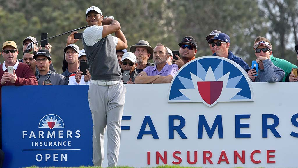 Tiger Woods follows through on Day 1 of Farmers Insurance Open.