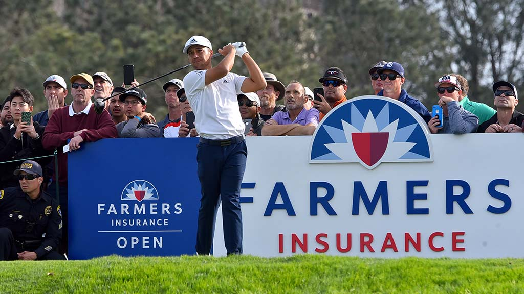 Xander Schauffele of San Diego led playing partner Tiger Woods by a stroke on Day 1 of Farmers Insurance Open