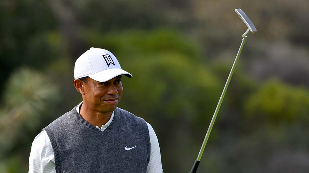 Tiger Woods salutes on South Course at Torrey Pines on Day 1 of the Farmers Insurance Open.