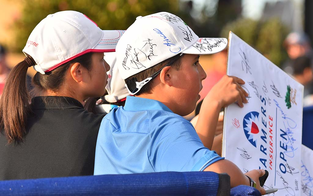 Kids collect autographs from pros at Farmers Insurance Open.
