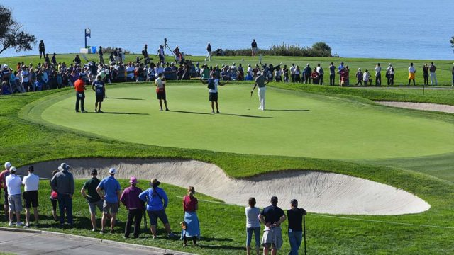 Golfers play the 5th hole of the south course of the Farmers Insurance Open in La Jolla.