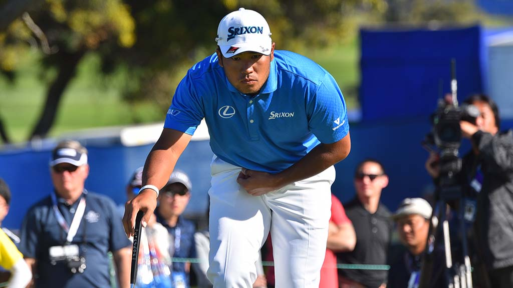 Hideki Matsuyama eyes the conditions before a putt at the Farmers Insurance Open at Torrey Pines Golf Course.