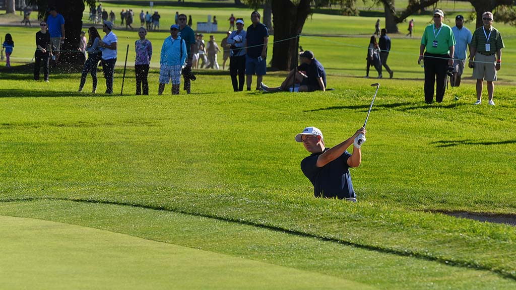Michael Thompson hits out of a sand bunker on the final day of the Farmers Insurance Open in La Jolla.