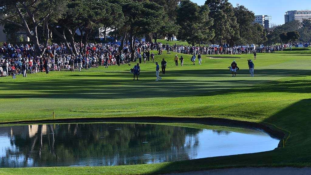 Players make their way up the fairway of the 18th hole of the Farmers Insurance Open at the Torrey Pines Golf Course.