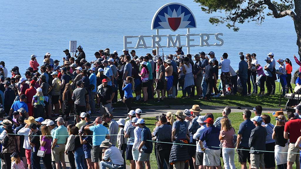 Spectators gather near the ocean's edge to watch the leaders play the final day of the Farmers Insurance Open in La Jolla.