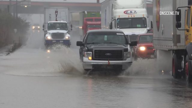 Trucks on a flooded road in Otay Mesa