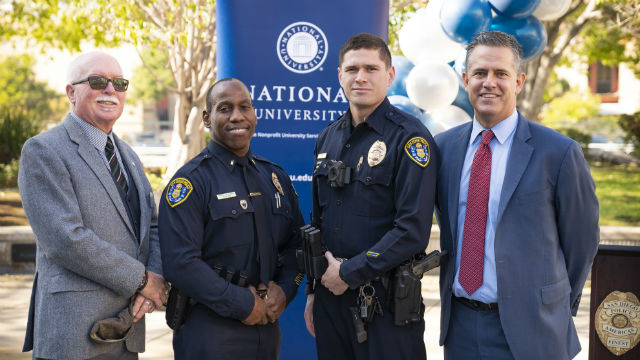 University officials and San Diego Police officers at National University