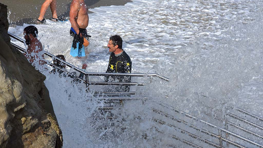 Swimmers climb the staircase after a swim in La Jolla Cove.